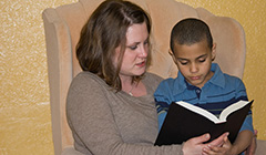 Young Mother and Son Reading Together